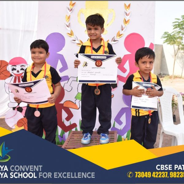 children in sports dress students at sports day prize distribution ceremony at cbse school english medium school