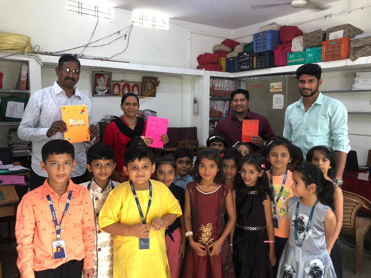 teacher-with-students-creating-cards-vijaya-convent-school